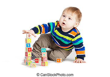 baby playing with wooden toy cubes with letters. Wooden alphabet blocks.