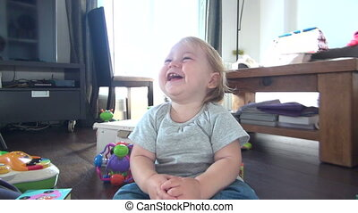 baby plays laughing