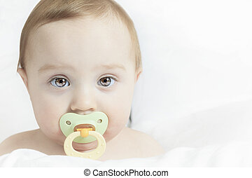 Baby portrait on the bed with white background