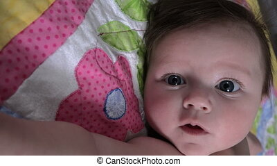 Baby Positioned With Arm - A great angle of a baby looking...