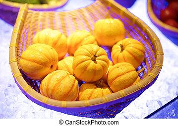 Baby pumpkins in basket