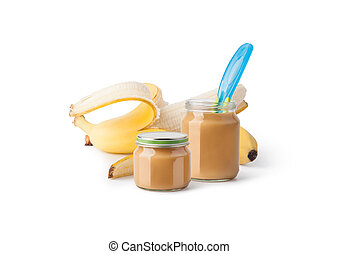 baby puree - Jar with banana baby food and spoon isolated on...