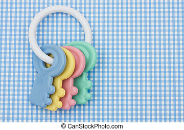 Baby Rattle - Colourful baby rattle on a blue background,...