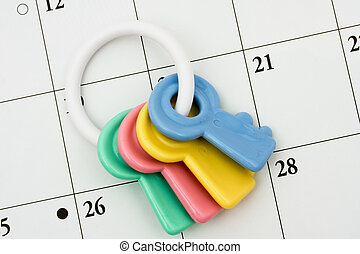 Baby Rattle - Colourful baby rattle on a calendar background...