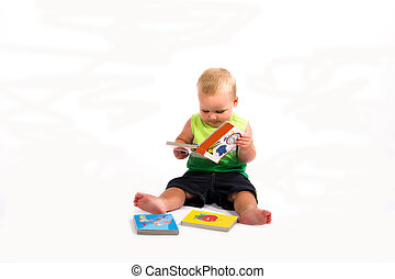 baby reading book - little boy learning to read, isolated