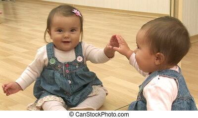 Baby Reflection - Eight month old baby play with own ...
