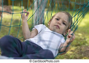 baby relaxing in the hammock