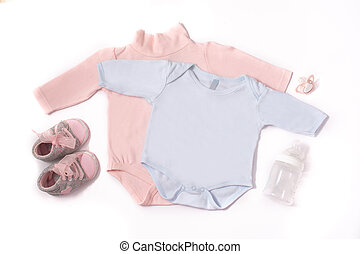 Baby rompers, shoes, feeding bottle and pacifier isolated on white background