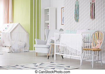 Baby room with chair, armchair and crib