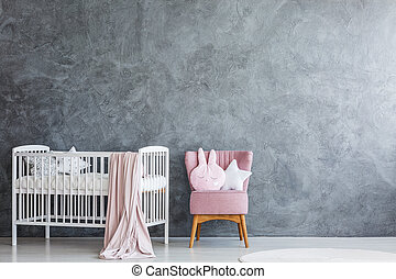 Baby room with crib and armchair