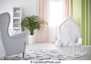 Baby room with rocking horse