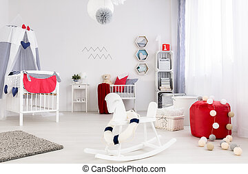 Room for a baby in bright colors with strong color accents