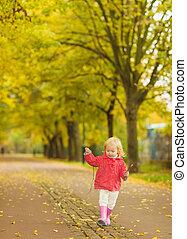 Baby running in park