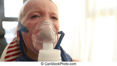 baby screaming crying in nebulizer mask vapor - baby...