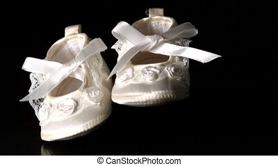 Baby shoes falling and bouncing on