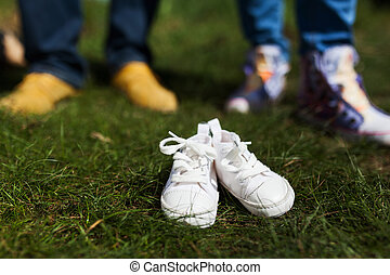 Baby shoes in front of future parents