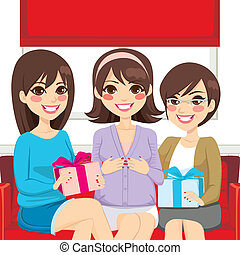 Three beautiful women on a baby shower family party making presents to pregnant woman
