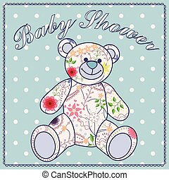 Baby shower with bear toy