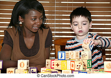 Baby Sitter - Beautiful african american woman playing...