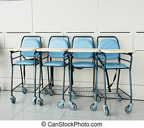 Baby sitting chairs - four baby blue sitting chairs in row ...