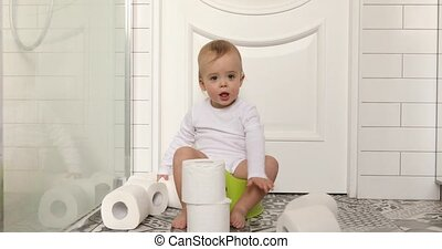 Baby sitting chamberpot his legs hanging down pot - Funny...