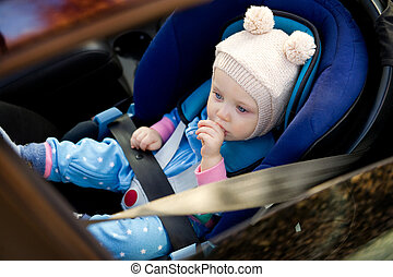 baby sitting in a car seat