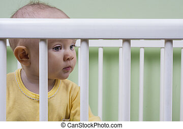 baby sitting in her crib