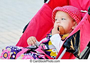 baby sitting in stroller