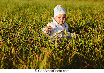baby sitting in the grass
