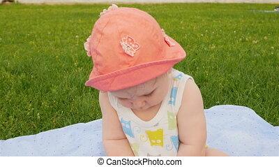 Baby sitting on grass