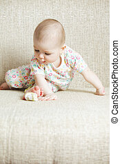 Baby sitting on sofa