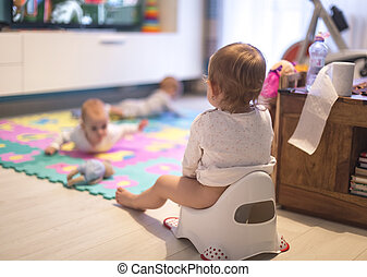Baby sitting on the potty