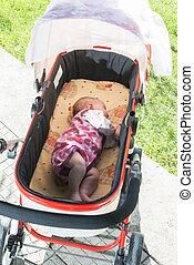 Baby sleep in baby buggy - Baby sleep in baby buggy. Close...