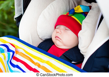 Baby sleeping in a stroller - Cute little baby in funny...