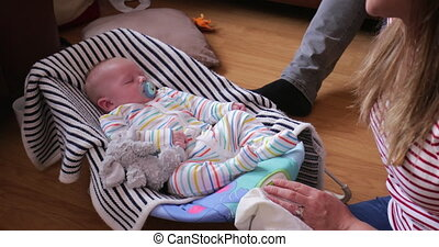 Baby Sleeping in Baby Bouncer - Baby sleeping in his baby...