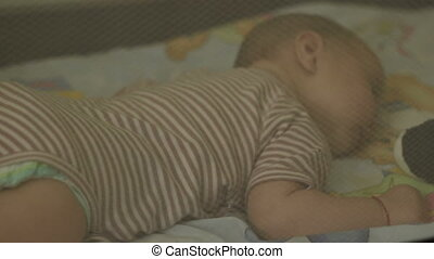Baby Sleeping in Bed - Peacefuly baby girl is sleaping and...