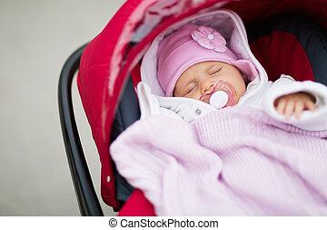 Baby sleeping in pram
