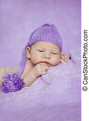 Baby sleeping. Newborn, kid art. Beauty child, boy or girl sleeps in a funny hat