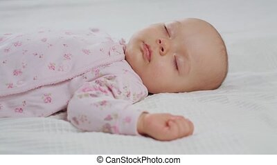 Baby Sleeping Sound on the Bed - A baby sleeping sound on a...