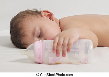 Baby sleeping with a bottle