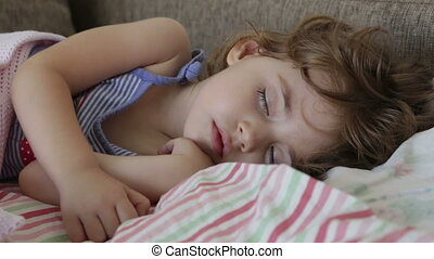 Baby sleeps in bed