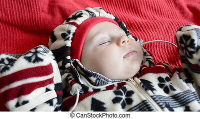 Baby sleeps in the street warm clothing