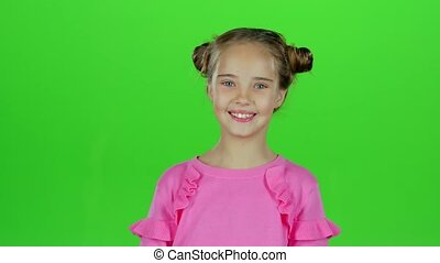 Baby smiles she's happy. Green screen. Slow motion