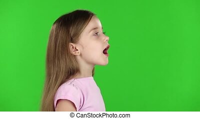 Baby speaks into a megaphone. Green screen. Side view. Slow motion