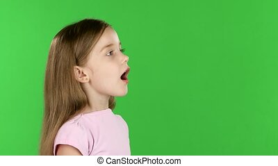 Baby speaks into a shout. Green screen. Side view