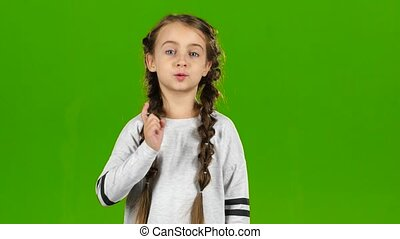 Baby speaks into the loudspeaker. Green screen - Baby speaks...