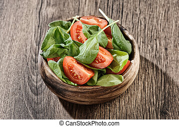 baby spinach salad on a plate