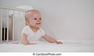 Baby Standing near the bed at Home