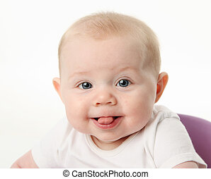 Baby sticking tongue out - Close up portrait of a baby with...