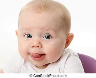 Baby sticking tongue out - Close up portrait of a baby with ...